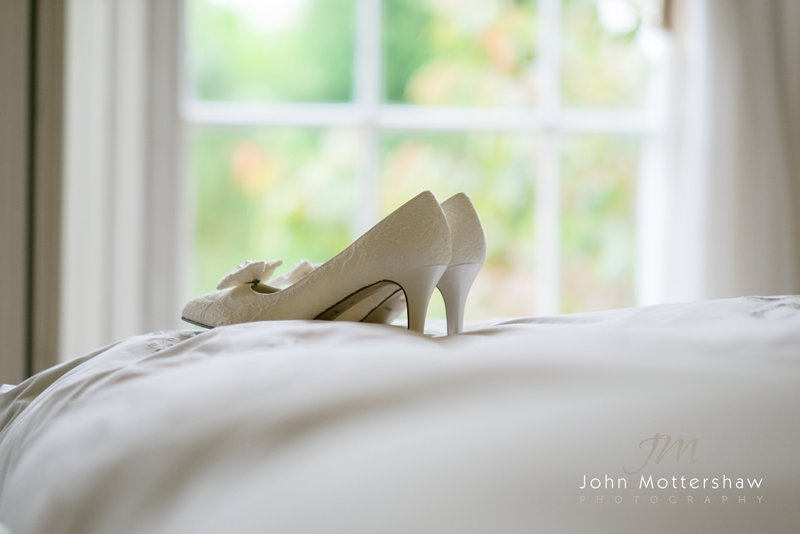 bride's shoes, ready for a wedding at Eyam Church in Derbyshire