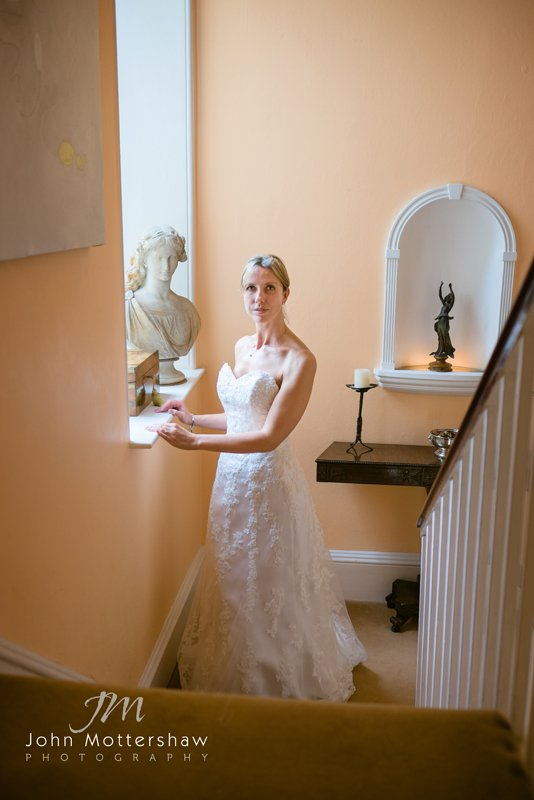 wedding photograph of a bride ready to go to Eyam Church in Derbyshire