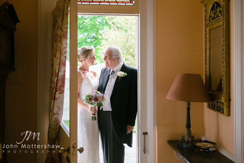 bride and her father before the wedding arriving at Eyam Church