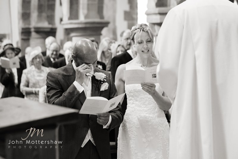 wedding photographer Sheffield: emotional moment at Eyam Church,