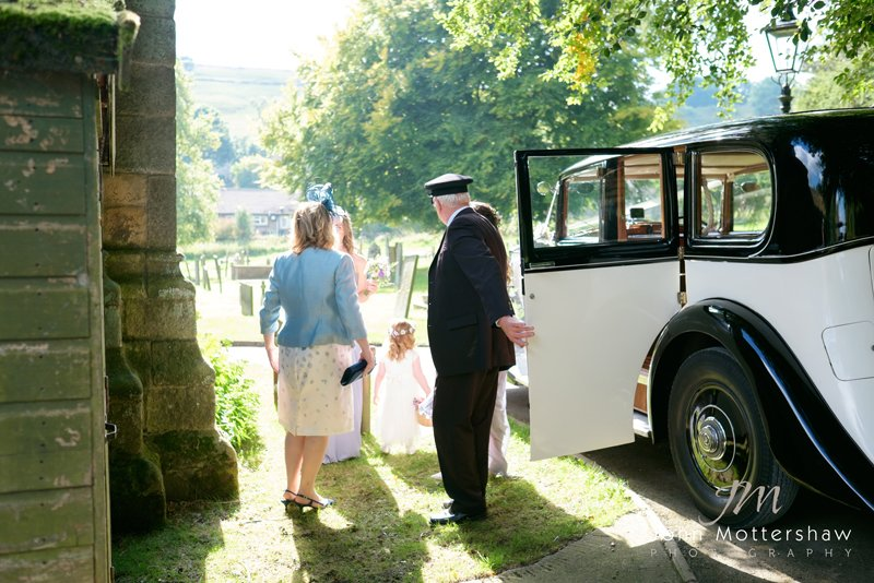 bride arrives in vintage Rolls Royce