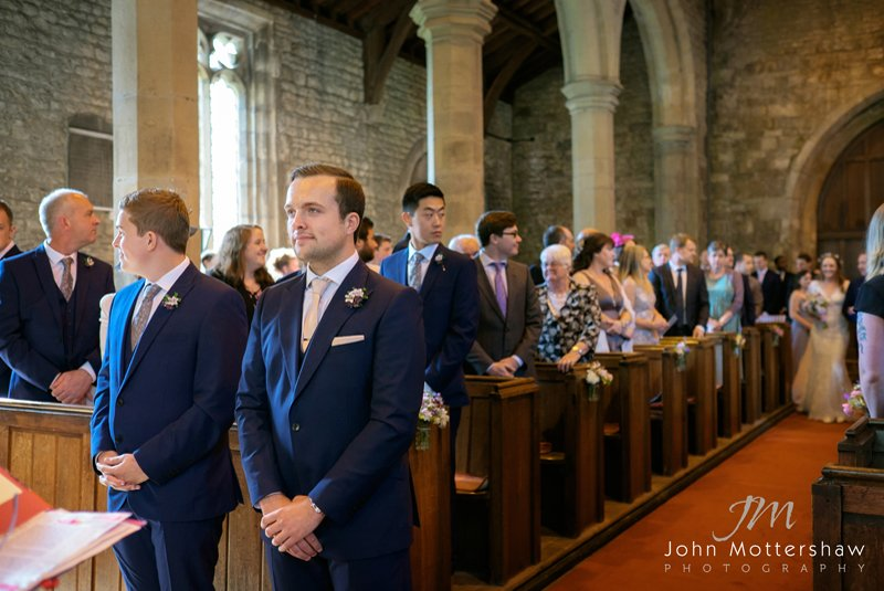 Groom awaits his bride in church