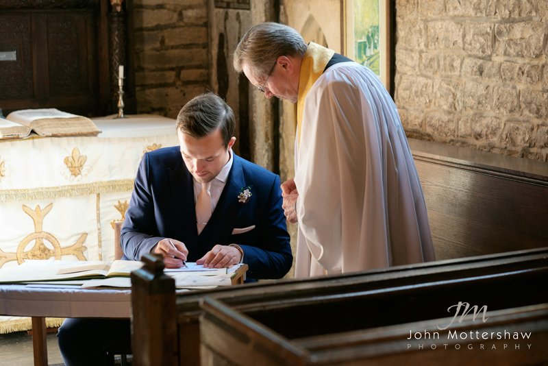 Wedding photography of signing the register