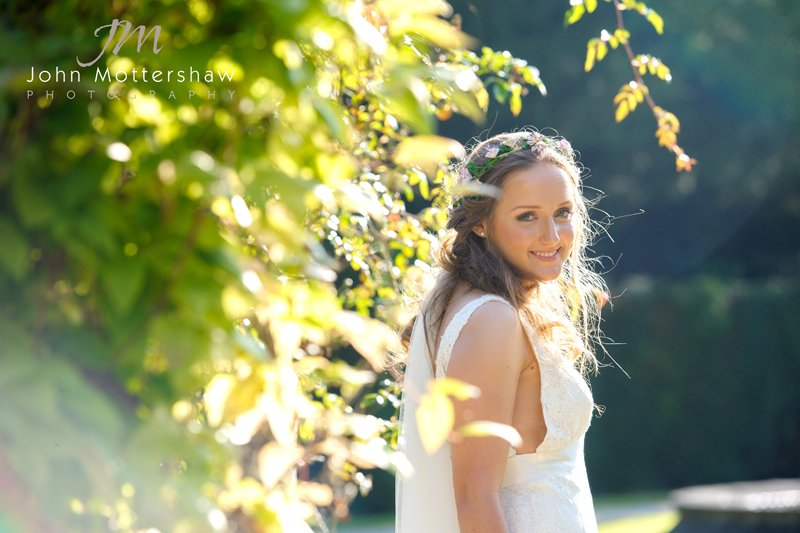 Wedding photography at Hassop Hall. Bridal portrait in the evening sunshine.