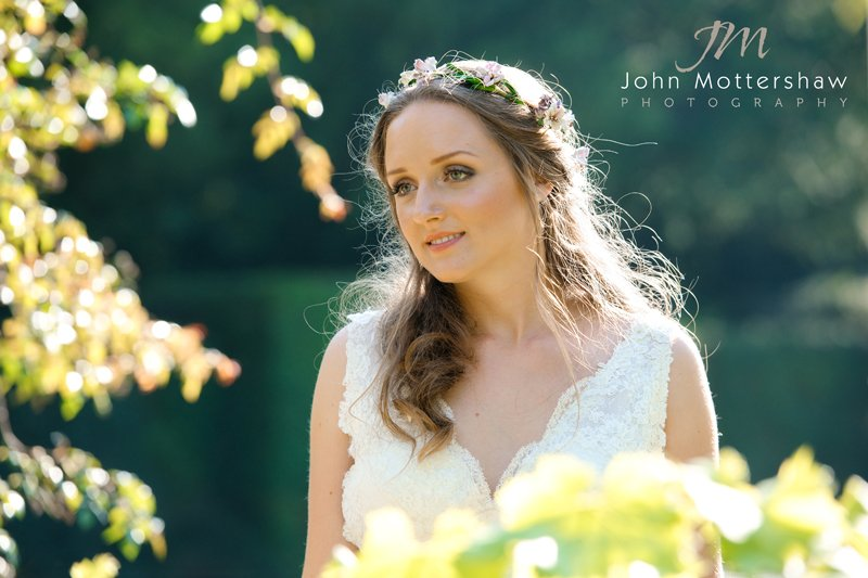 Wedding photography at Hassop Hall. A bride enjoys the evening sunshine.