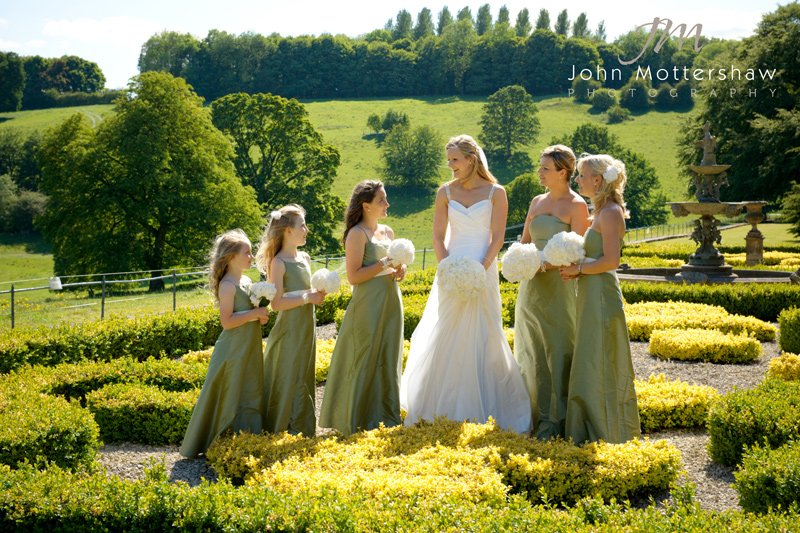 wedding photograph of a bride and her bridesmaids at Hassop Hall