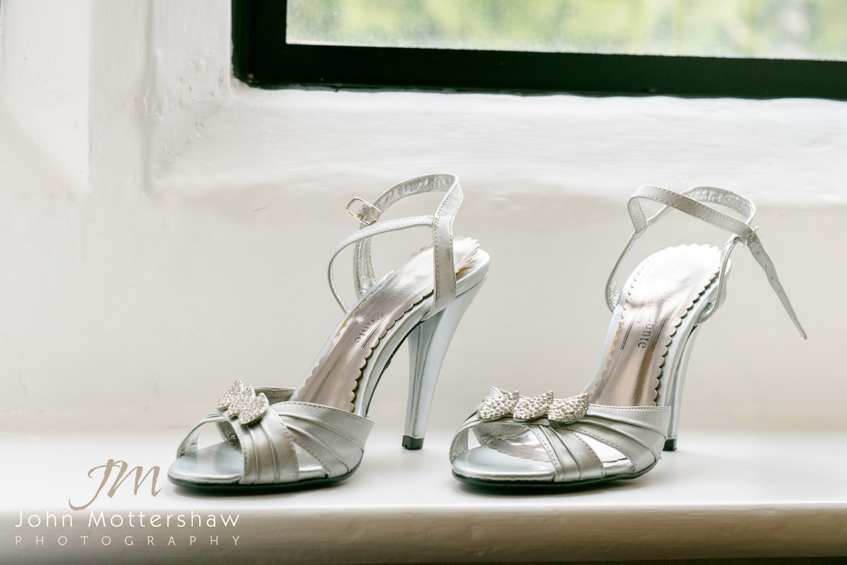 Wedding photograph of bride's shoes