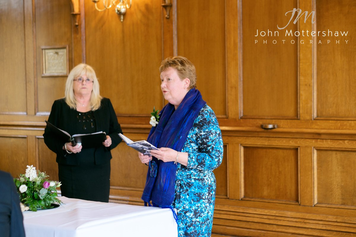Bride's mother does a reading at wedding at the Maynard in Derbyshire