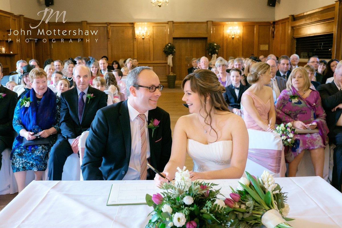 signing at the register at a Maynard wedding