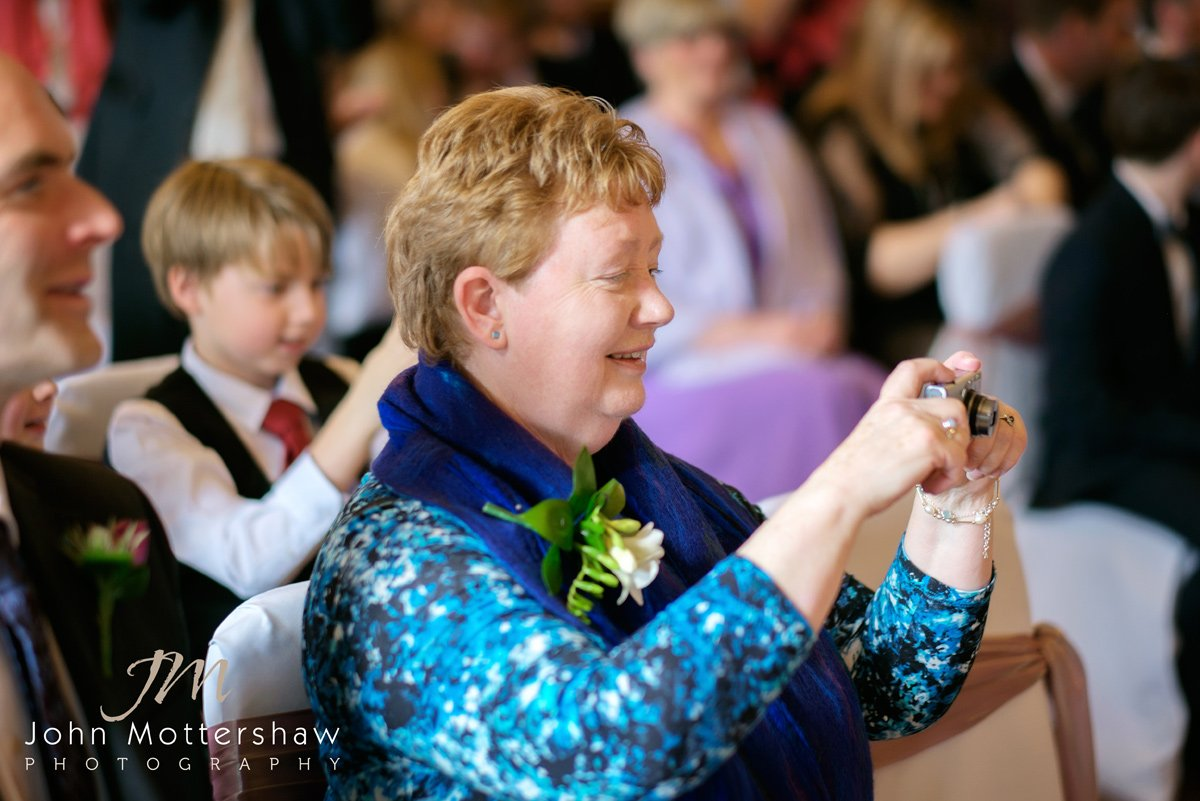 Groom's mother taking photographs