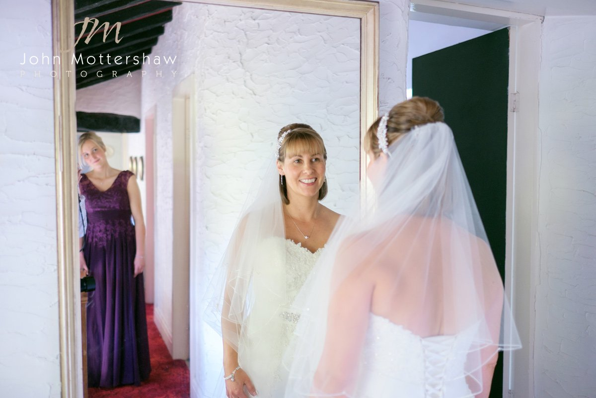 A Cheshire bride takes a final check in the mirror