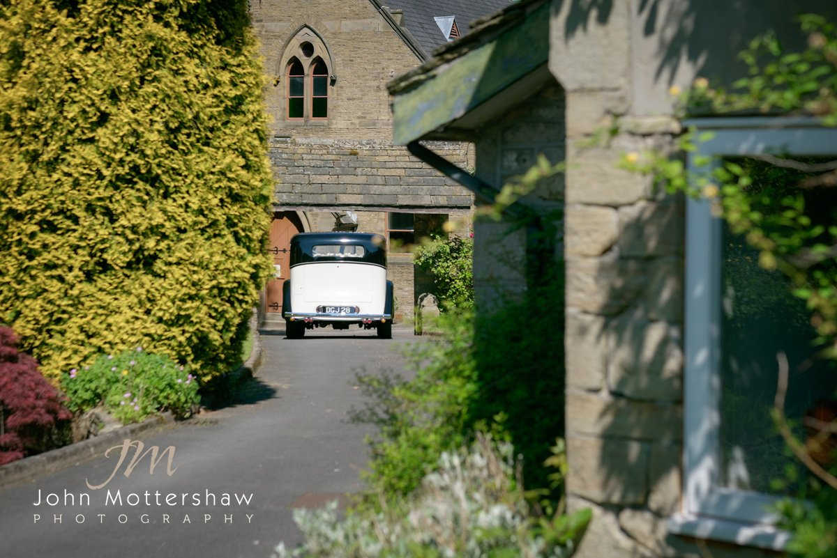Vintage Rolls Royce arrives to take the bride to her church wedding in Cheshire