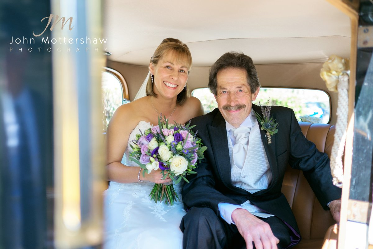 The bride and her father arrive at Taxall Church in Cheshire