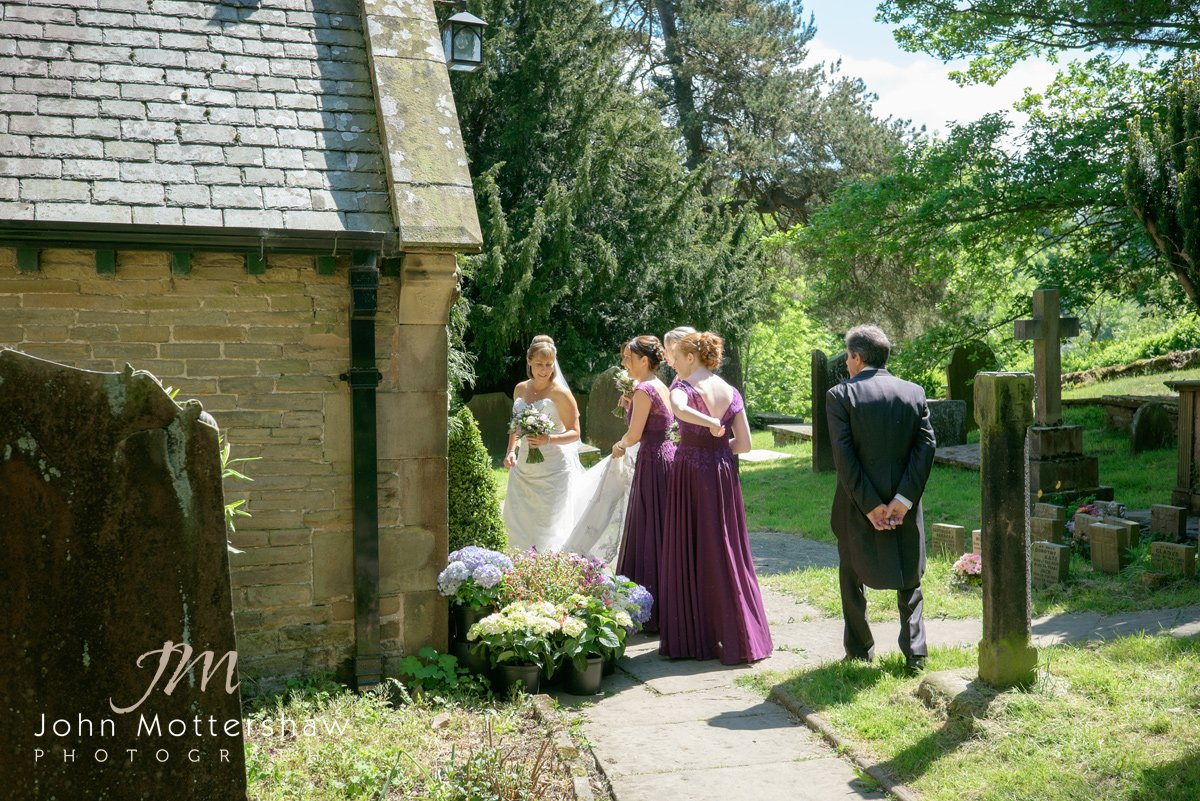 bride and bridesmaids arrive at a Cheshire church ceremony before going on to Shrigley Hall in Cheshire