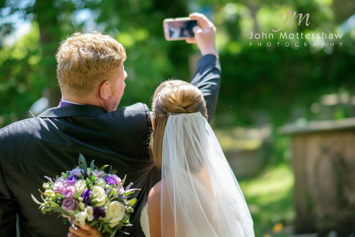 bride and groom take a selfie at Shrigley Hall in Cheshire