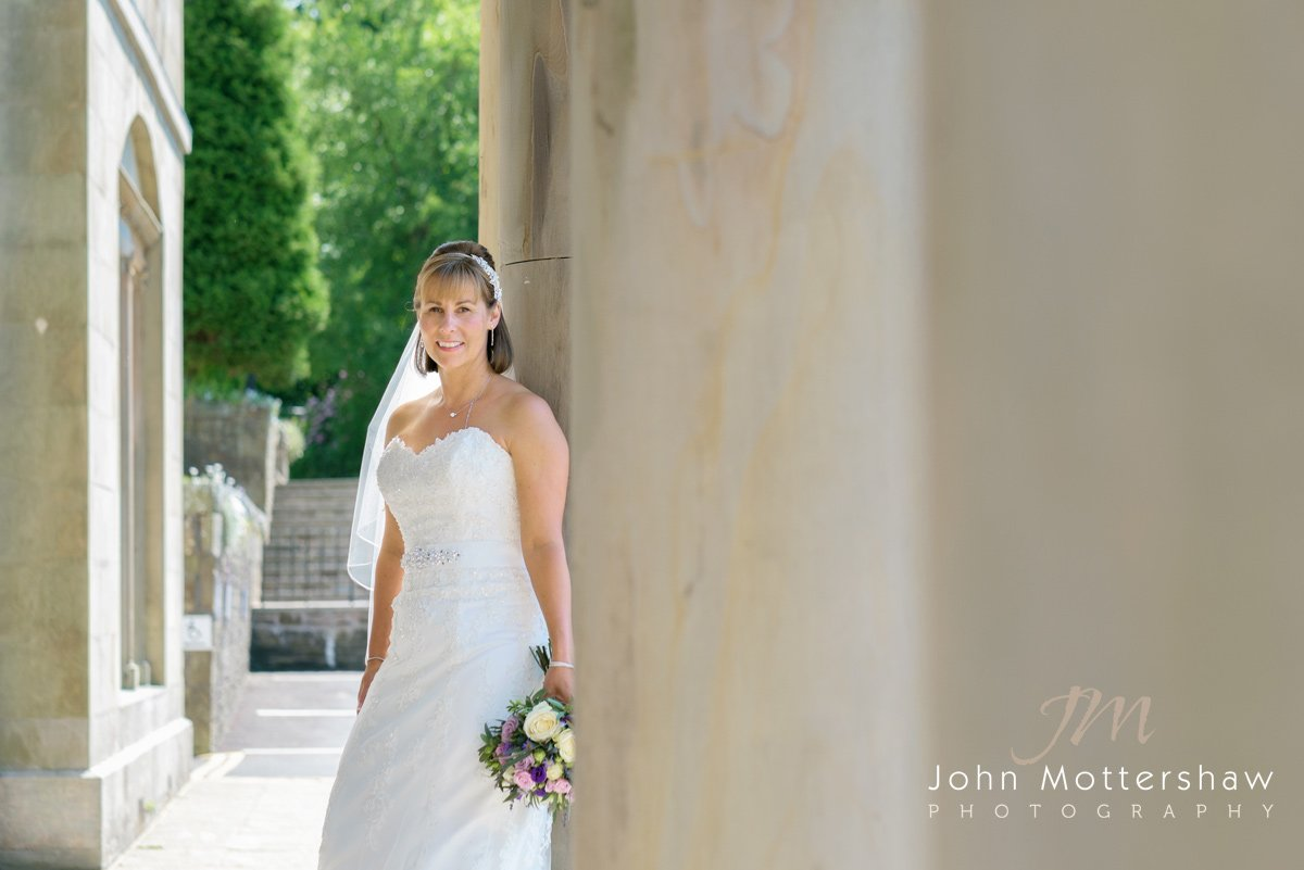 a bride poses at a Shrigley Hall wedding