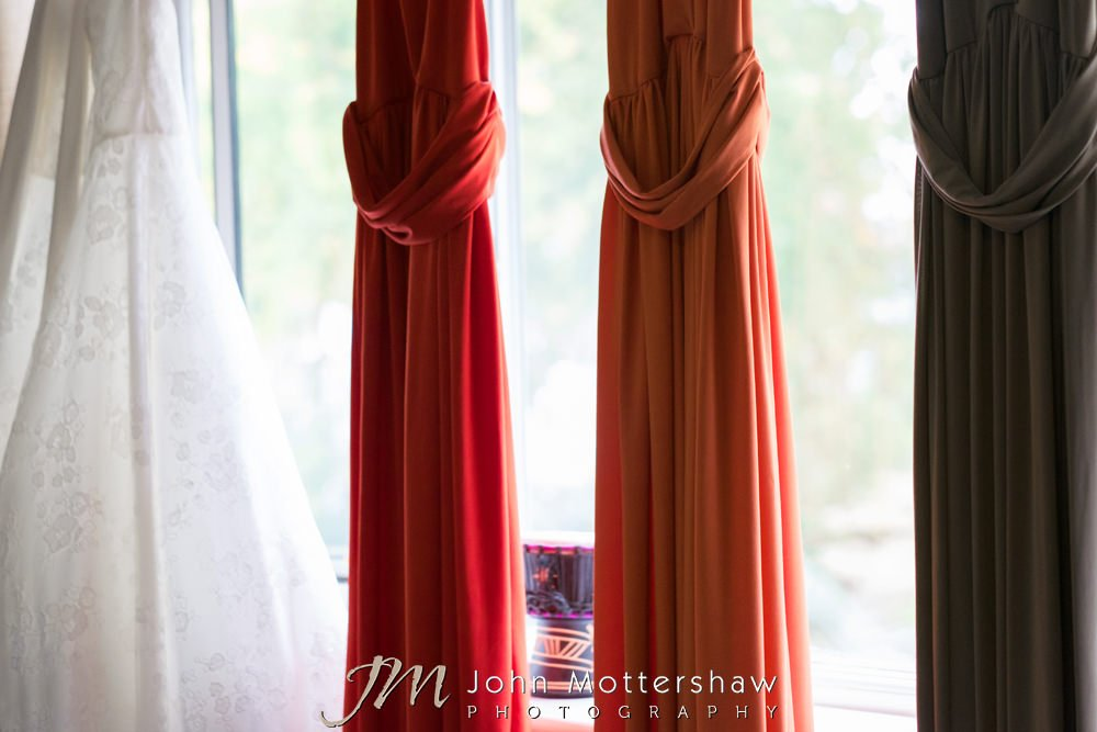 Wedding gown and different colour bridesmaids dresses
