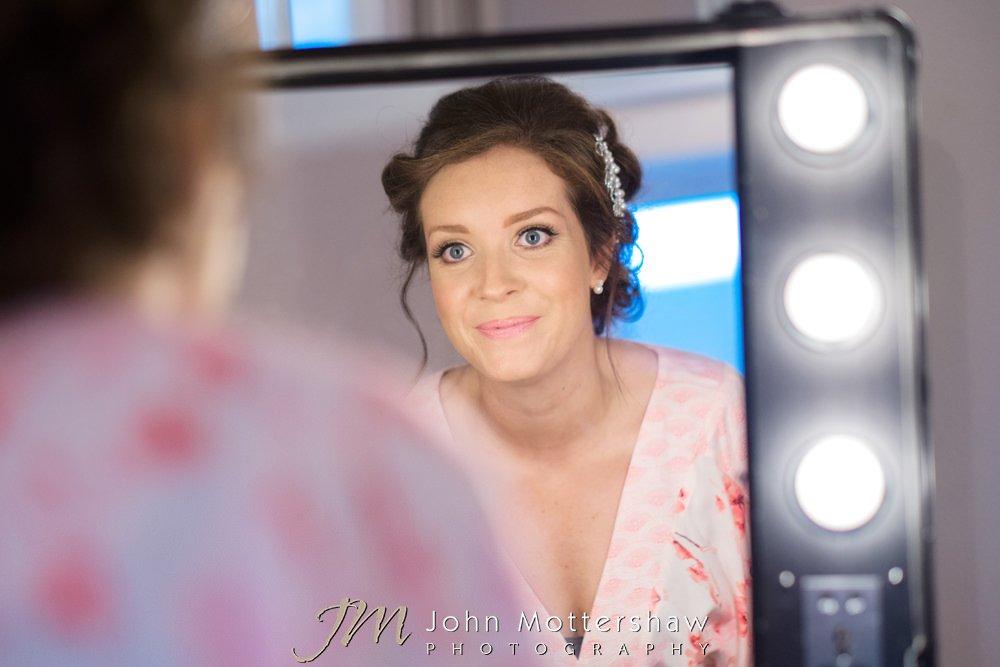 Bride looking in the mirror