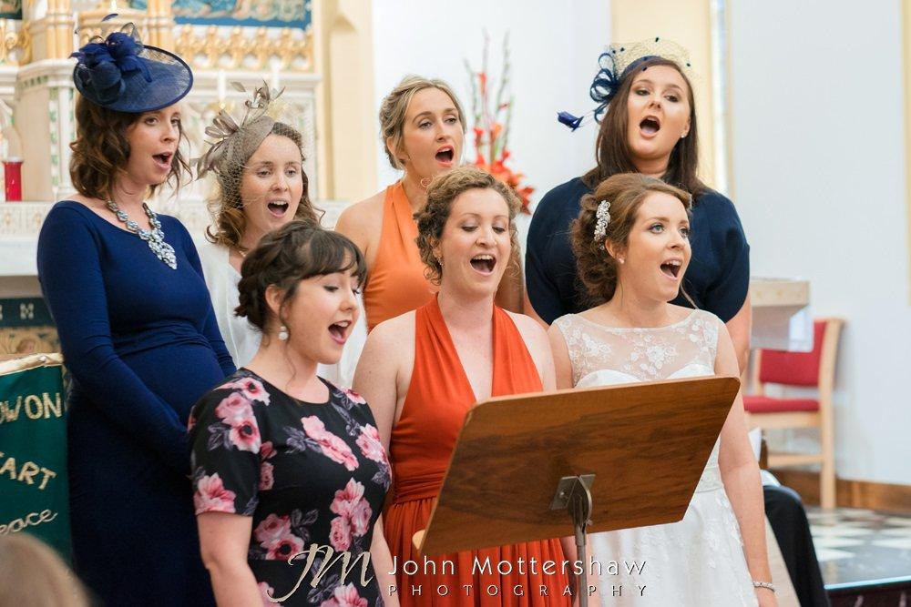 Wedding choir and bride singing