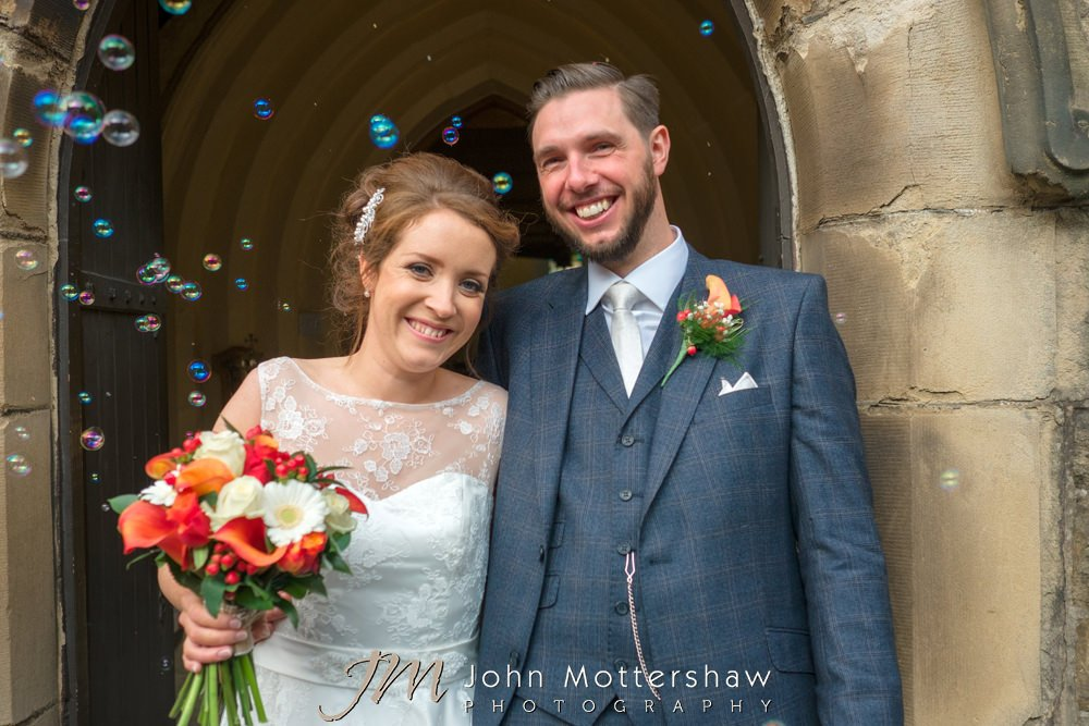 Bride and groom with bubbles