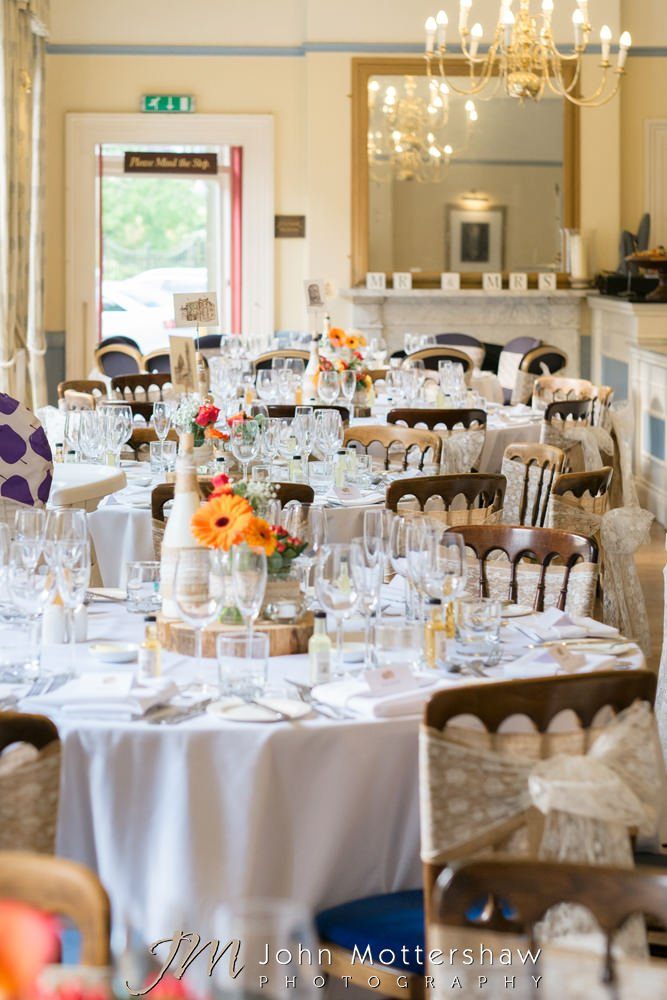 Wedding reception room at Old Hall Buxton with lace and hessian chair sashes