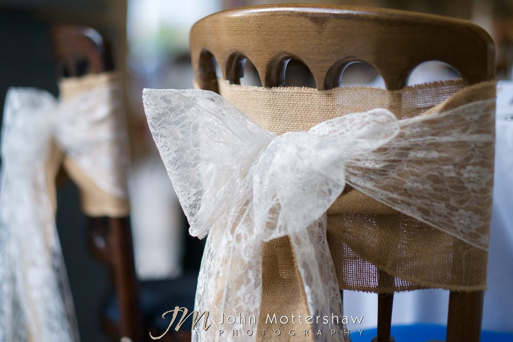 Lace and hessian chair sashes