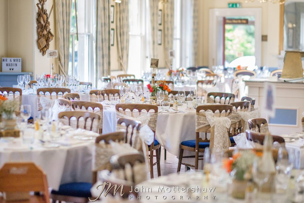 Buxton Old Hall wedding reception room with lace chair sashes