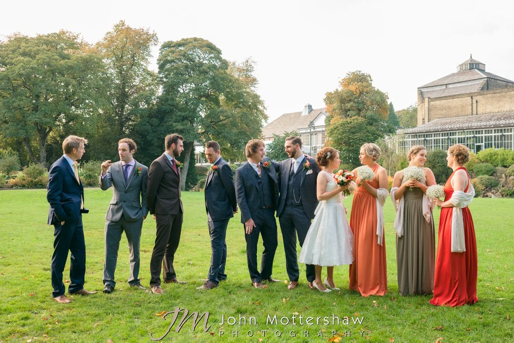Relaxed group portraits in the Pavilion Gardens at Old Hall Buxton wedding