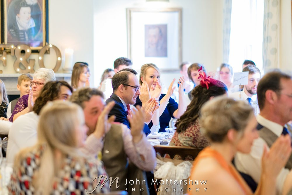 Wedding guests clapping during speech