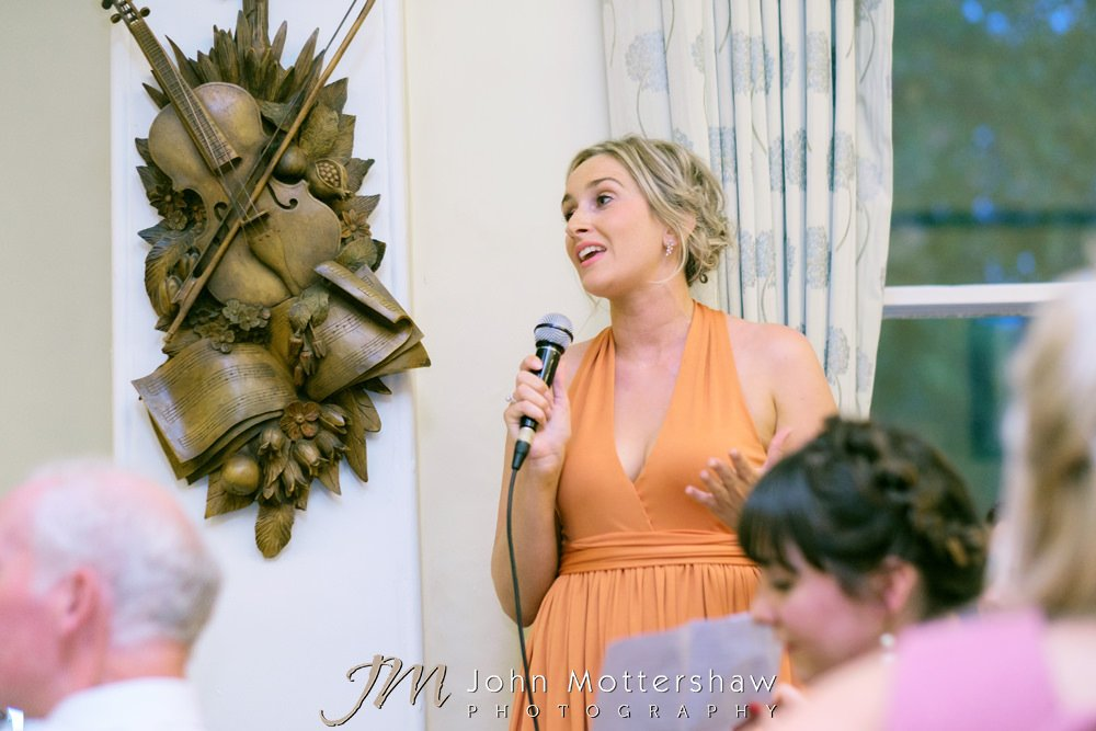 Bridesmaid giving a wedding speech