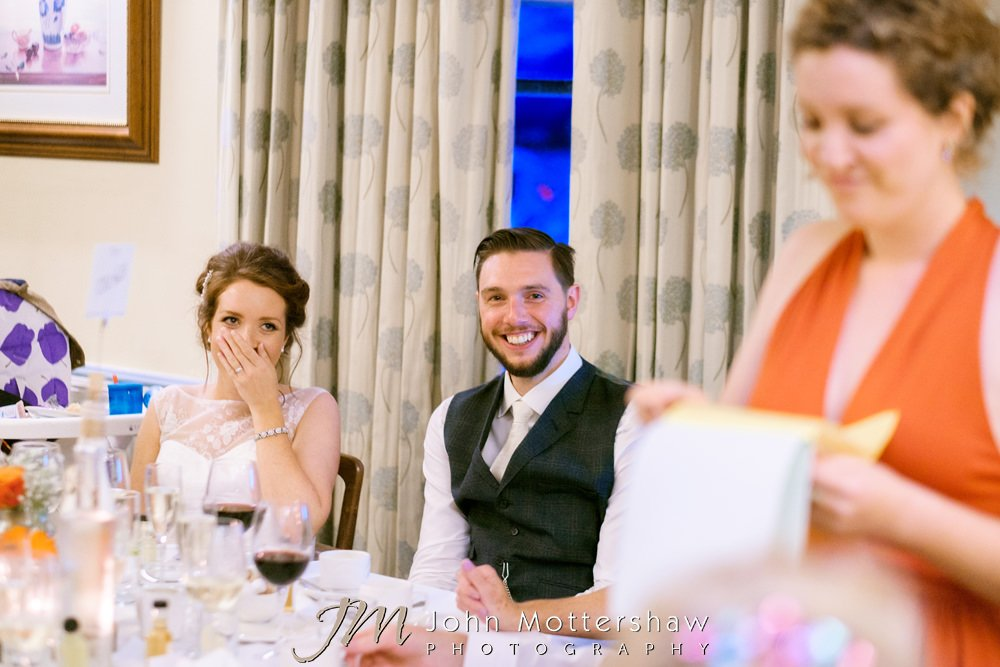 Bridesmaid speech with bride and groom