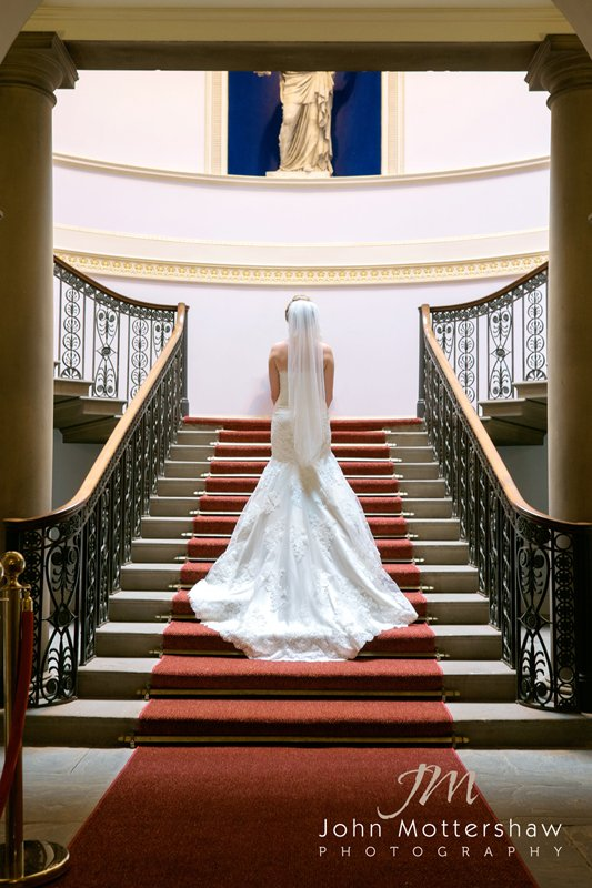 Bride on the staircase at Wentworth Woodhouse wedding