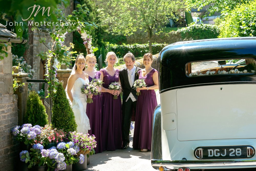 The bride arrives at Taxal Church for her wedding. Photograph by Sheffield wedding photographer John Mottershaw.
