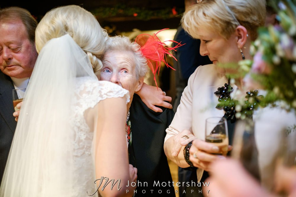 Bride hugging grandmother