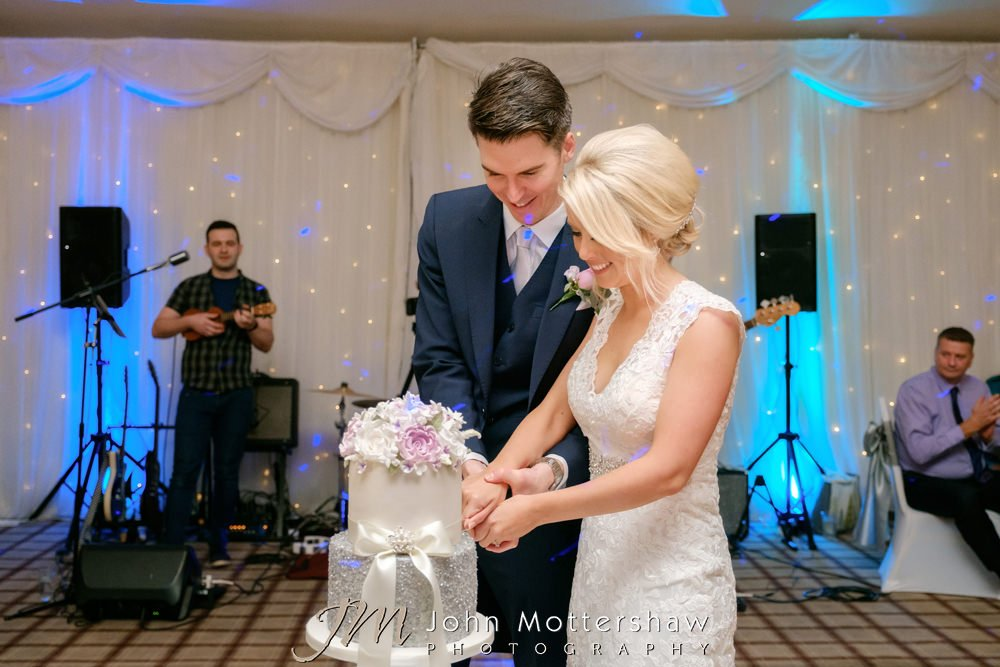 Sheffield wedding photography of cake cutting