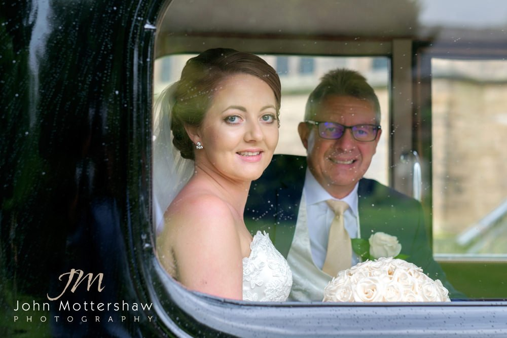 The bride arrives at her Wentworth Church wedding in a vintage car with her father.