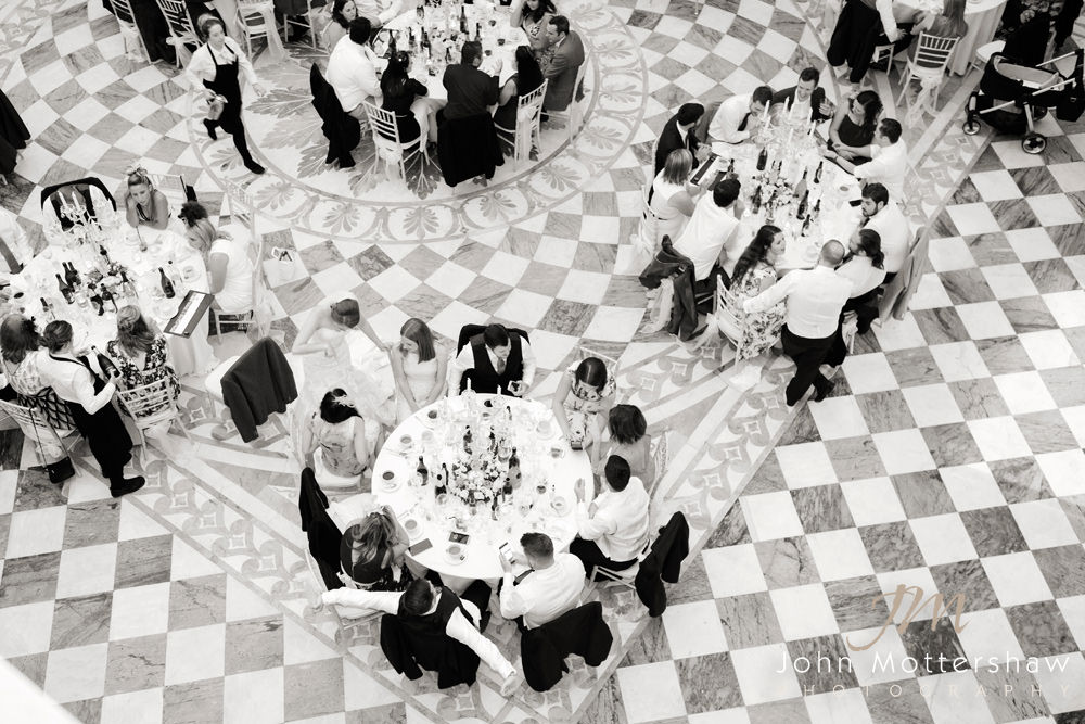 Black and white photograph from above of wedding reception at Wentworth Woodhouse near Sheffield.