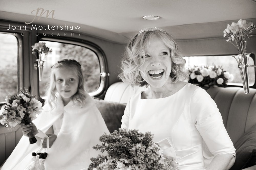 A bride arrives at her wedding at Stannington Church. Photograph by Sheffield wedding photographer John Mottershaw.