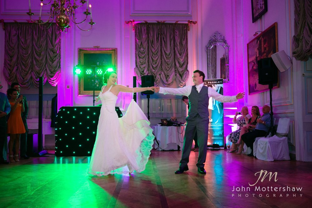 A colourful first dance at a Hassop Hall wedding.