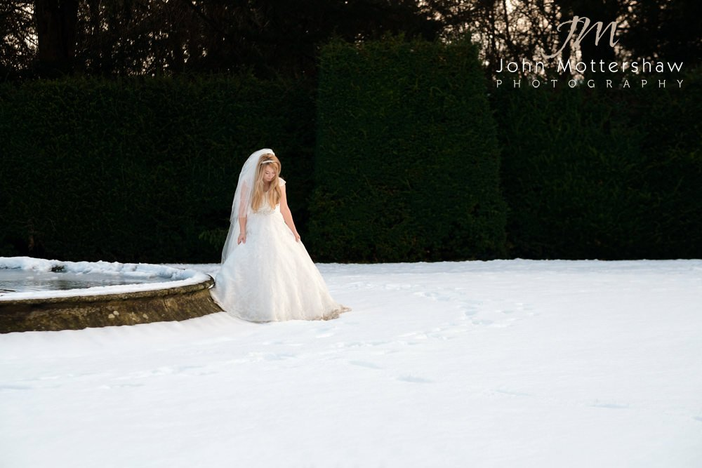 A Christmas white wedding at Hassop Hall by Sheffield wedding photographer John Mottershaw.