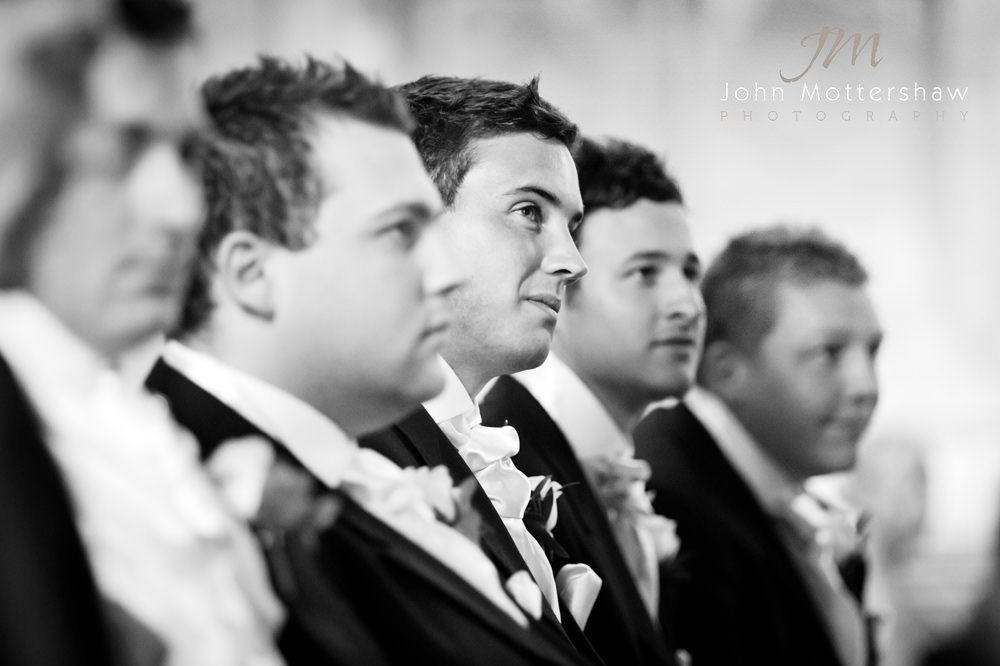 groomsmen at a church wedding in Sheffield, looking on as the marriage ceremony takes place.