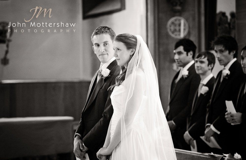 Black and white wedding photograph of a church ceremony at St Marie's Church in Sheffield
