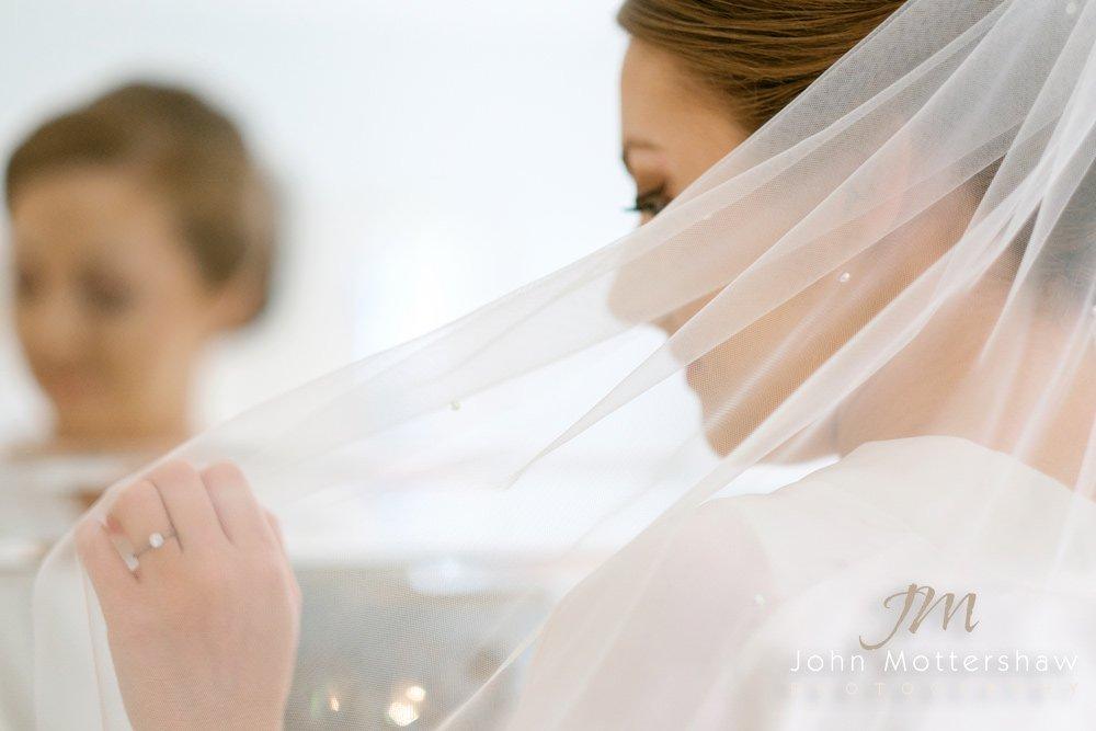 Wedding photograph through the bride's veil. Photograph by Sheffield wedding photographer John Mottershaw.