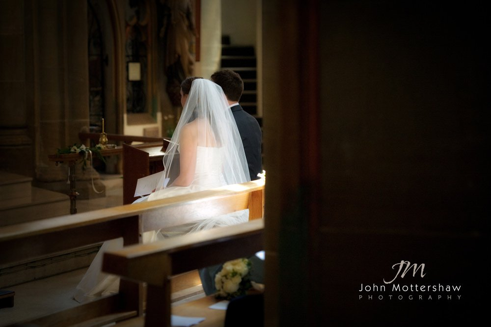 Bride and groom at their church wedding at Saint Marie's in Sheffield. Reception was at Thornbridge Hall.