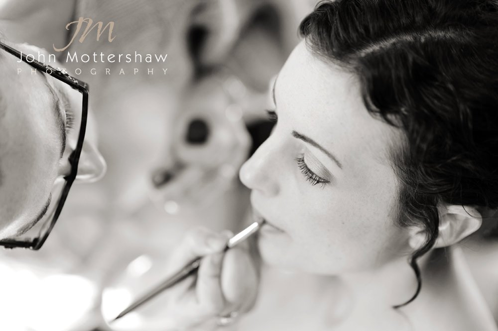 Black and white wedding photography of bridal make up, before her Losehill House wedding, near Sheffield.