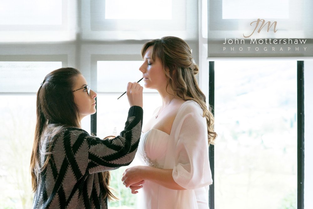 Wedding photographer Sheffield photographs a bride having her make up done for her wedding at the Maynard.