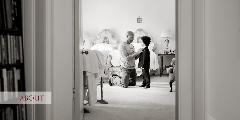 A wedding preparation shot showing a father helping his young son to get ready for the church wedding. A documentary wedding photography by Sheffield wedding photographer John Mottershaw.