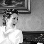 Wedding photographer Sheffield. Humorous black and white wedding photograph of bridal preparation at Whitley Hall.