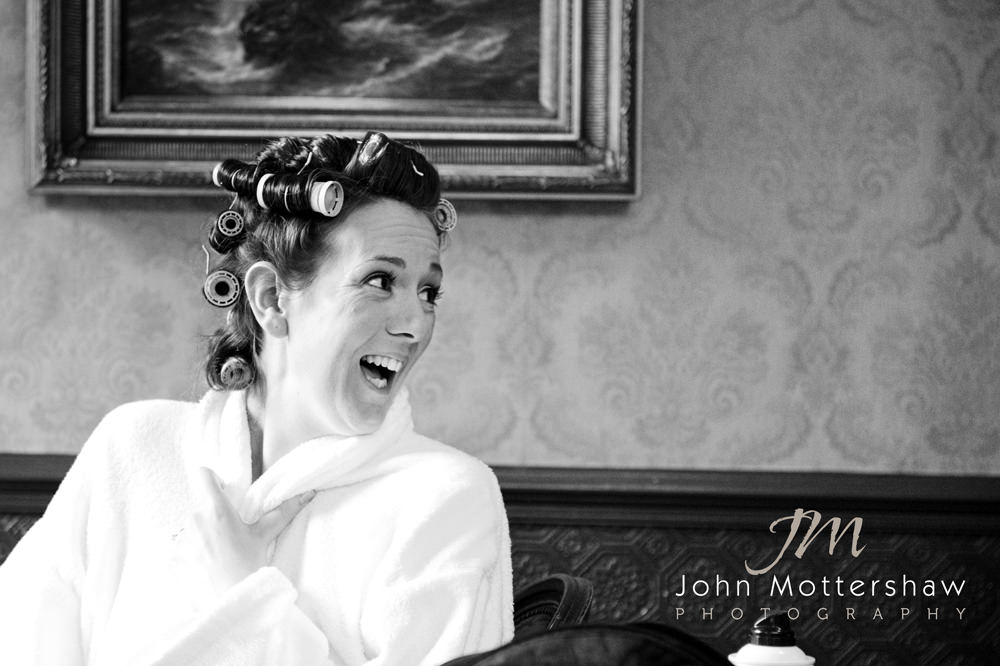 Humorous black and white wedding photograph of bridal preparation at Whitley Hall in Sheffield.