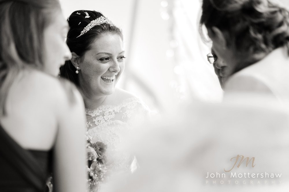 Sheffield Wedding photographer captures a bride laughing during her civil wedding at Woodthorpe Hall.